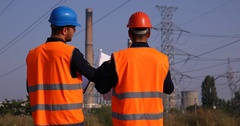 Engineer Men Talking About Energy Technology Plans Power Plant Industrial Area Stock Footage