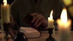 Closeup of 1830 man writing in his diary by candlelight 4k Stock Footage