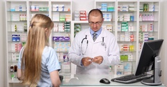 Experienced Pharmacist Give Medicine Pills to a Young Woman Pharmaceutical Shop Stock Footage