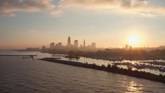 CLEVELAND, SKYLINE, OVER MARINA THEN OVER LAKE ERIE, ROM WEST Stock Footage