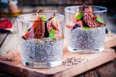 Chia seed pudding with baked figs, honey and mint Stock Photos