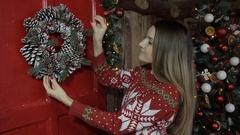Christmas, New Year, woman, girl, decorate a room, Christmas wreaths Stock Footage