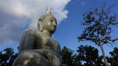 The buddha statue with cold moving on blue sky Stock Footage