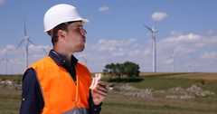 Wind Turbines Field Worker Man Eating Sandwich Lunch Break Windpower Plant Farm Stock Footage