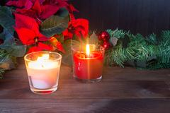 Christmas decor with red candles and poinsettia Kuvituskuvat