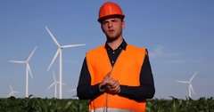 Convinced Young Engineer Man Talking Wind Turbines Field Looking Camera Reporter Stock Footage
