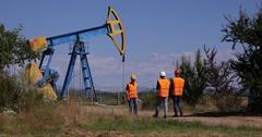 Energy Industry Engineer Men Walk Teamwork Meeting Collaboration Talk Oil Pump Stock Footage