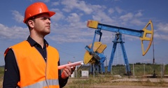 Attractive Engineer Man Holding Plan Looking At Oil Pump Petroleum Installations Stock Footage