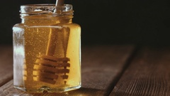 Close up of honey stick in jar Stock Footage