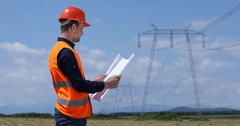 Young Engineer Man Examining Plan Scheme of Electricity Tower Energy Industry Stock Footage