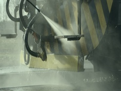 Water jet washes oiled from the front bumper to train in slow motion Stock Footage