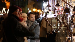 People walk watch souvenirs at the Christmas Fair in Wroclaw Poland Stock Footage