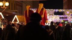 People crowd walking at bright illumination Christmas Fair in Wroclaw Poland Stock Footage