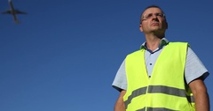 Airport Staff People Man Look Around Checking Report Aircraft Passing Overhead Stock Footage