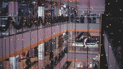 Slightly defocused crowd of walking people in the newly opened shopping mall Stock Footage