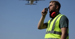 Airport Worker Man Communication Walkie Talkie Airplane Vehicle Passing Overhead Stock Footage