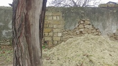 Old ruined brick fence on city street Stock Footage