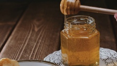 Wooden honey stick watering cheesecake Stock Footage