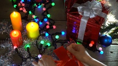 Woman in Cap Santa Wraps Christmas Presents Under the Christmas Tree Stock Footage