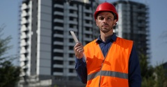 Convinced Architect Expert with Plan Look Camera Serious Under Development Site Stock Footage