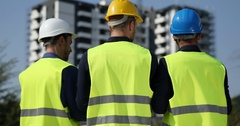 Engineers Talking Team Work Activity Men Collaborate Under Construction Building Stock Footage
