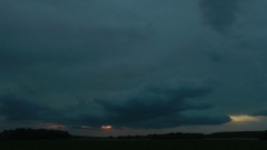 Terrible rain clouds have closed themselves the setting sun. Time-lapse. Stock Footage