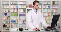 Young Pharmacist Specialist Man Talking Mobile Phone with Drug Company Pharmacy Stock Footage