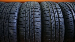 Car tyres in a row Stock Footage
