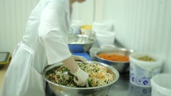 Woman on the production of preparing a vegetable salad in a large bowl Stock Footage