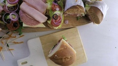 Time-lapse. Step by step. Fresh sub sandwich on white and wheat hoagies. Stock Footage