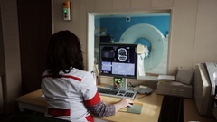 Experienced doctor looking at MRI scan of lumbar region on Monitor Stock Footage