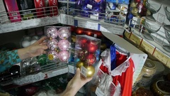 Buying Christmas toys and decorations in supermarket Stock Footage