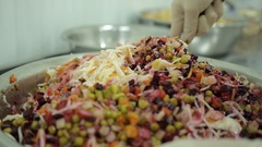 The chef prepares a fresh salad with vegetables in a large dish Stock Footage
