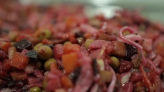 Vinaigrette beet salad for a vegetarian diet on the plate closeup Stock Footage