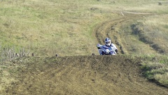 Motocross racing ATV bike to turn in slow motion Stock Footage