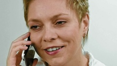 Short hair blond woman talks by mobile phone Stock Footage