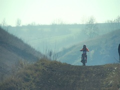 Motocross racing bike with a small muddy track in slow motion Stock Footage