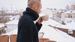 Young man with moustache coffee drinkers on the rooftop. Winter Stock Footage