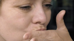 Woman licks her fingers after finishing her meal Stock Footage