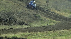 Motocross racer ATV on mountain track in slow motion Stock Footage