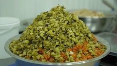 Vegetables for salad in a large bowl on the manufacturing closeup Stock Footage