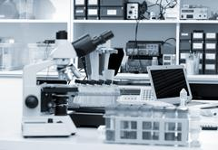 Science laboratory with a microscope, biological material samples and a computer Stock Photos