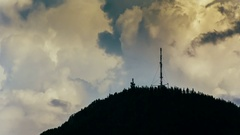 4K Time lapse radio tower on mountain peak with hard clouds background. Stock Footage