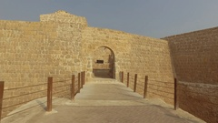 Entering the fort in Bahrain known as Qal'at al-Bahrain Stock Footage