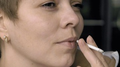 Smoking female with a cigarette in her hand Stock Footage