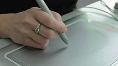 A woman draws with pen tablet digitizer and stylus Stock Footage