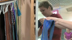A female customer is trying on a blue waistband Stock Footage