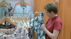 A customer searches the best suitable size for her Stock Footage