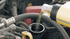 Auto mechanic pours additional motor engine oil Stock Footage