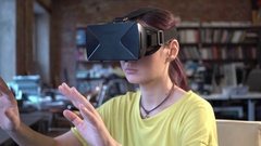 Woman in VR glasses looking up and touch objects Stock Footage